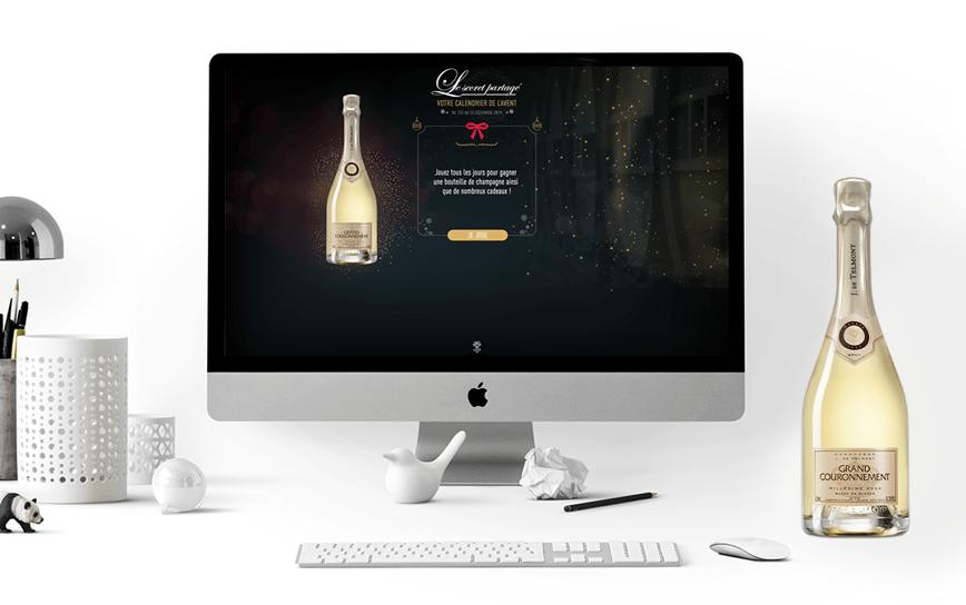 Visuel jeu Champagne De Telmont dans un ordi, sur un bureau aménagé