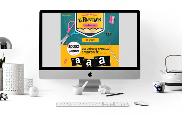 Visuel jeu BestDrive dans un ordi, sur un bureau aménagé